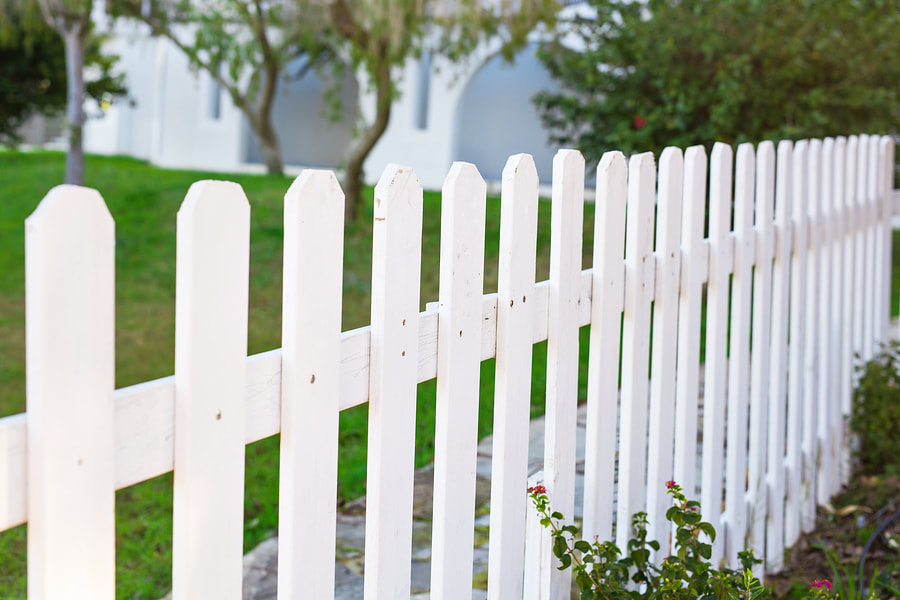 completed pretty white vinyl fences