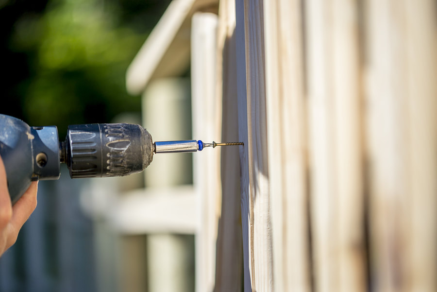 professional fence worker working on fence installation